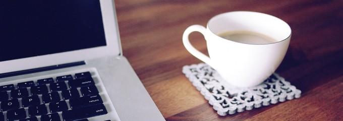teacup next to laptop