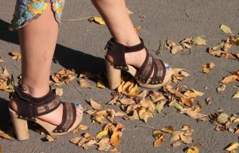 woman walking on leaves