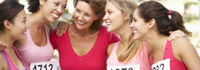 women huddling at a marathon