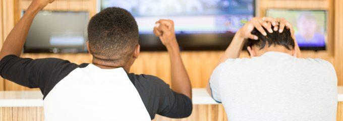 cheering at the tv