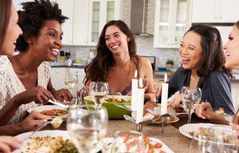 Friends eating dinner together
